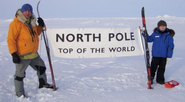 Family snap: Alan Chambers stands at the North Pole with his son, Oliver (Pictures: SWNS)