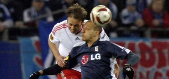 Bobby Zamora competes for the ball with Joris Mathijsen