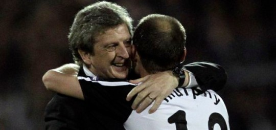 Fulham manager Roy Hodgson hugs captain Danny Murphy following their victory over Hamburg