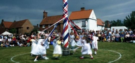 Morris dancing around the Maypole