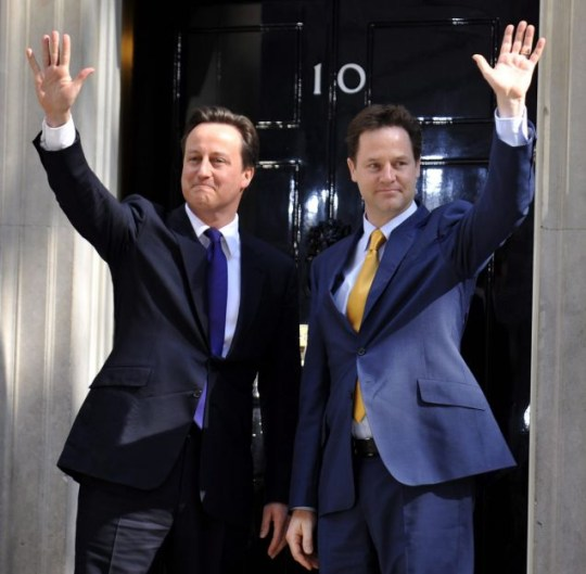 epa02153420 New British Prime Minister David Cameron (L) and his new Deputy Prime Minister Nick Clegg wave to the press outside 10 Downing Street in London, Britain, 12 May 2010. Conservative Party leader David Cameron became the UK's new Prime Minister 11 May and heads a coalition government with the Liberal Democrats who have been handed a number of cabinet positions.  EPA/ANDY RAIN