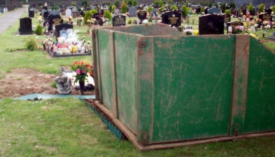 Anger: An ugly green skip sits on boards on top of the grave of Robert Graham in Eston Cemetery, Teesside (Picture: NNP)
