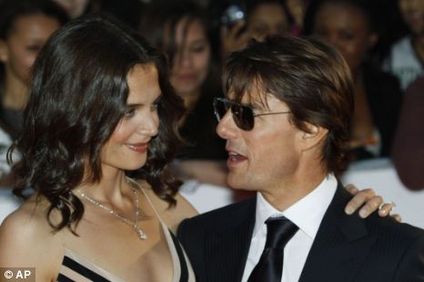 Tom Cruise, right, poses with his wife U.S. actress Katie Holmes