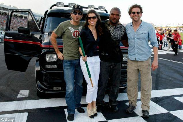 Quinton Jackson poses with Sharlto Copley, Jessica Biel and Bradley Cooper