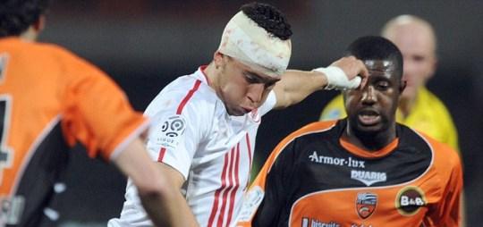 Lille's midfielder Eden Hazard vies with Lorient's French midfielder Arnold Mvuemba