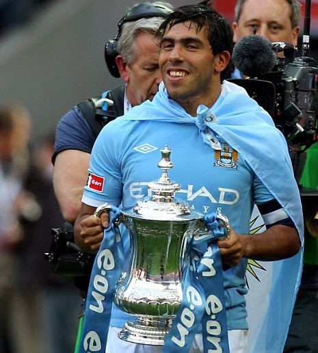 Carlos Tevez celebrating Manchester City's victory over Stoke in the FA Cup final