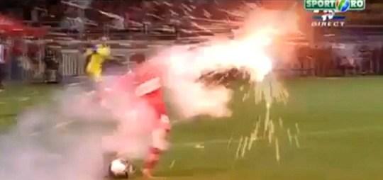 Elis Bakaj of Dinamo Bucharest dodges flare