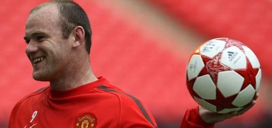 Manchester United's forward Wayne Rooney smiles