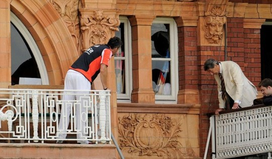 England's Kevin Pietersen and an MCC steward inspect the window broken by Matt Prior in the Lord's pavillion