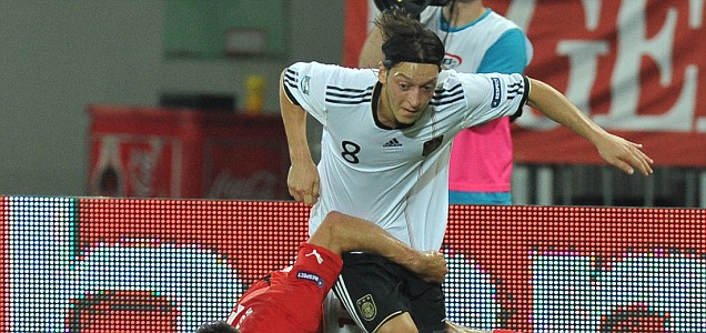 Germany's Mesut Ozil fight for a ball