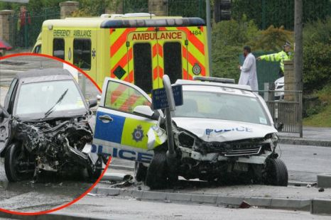 A police car in a 999 call was in collision with a hire car in Leeds as heavy rain fell upon the area (Picture: Yorkshire News Service)