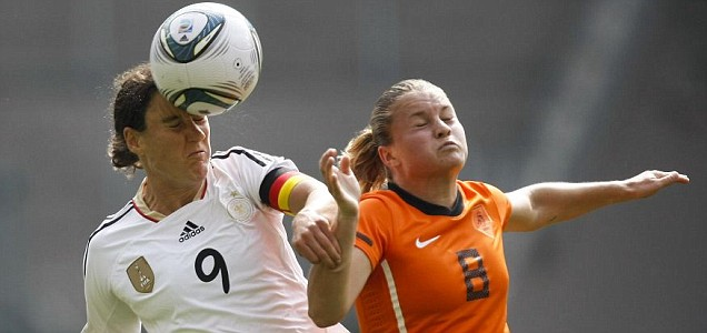 Germany's Birgit Prinz is challenged by Sherida Spitse of the Netherlands