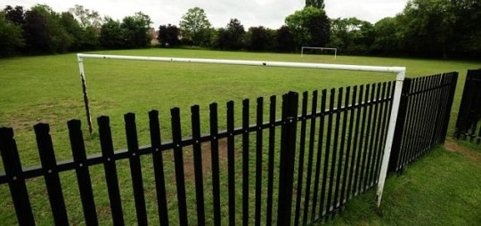fence runs straight through goalposts in York playing field