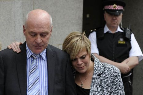 Bob Dowler, father of slain schoolgirl Milly Dowler, reads a statement next to his daughter Gemma, outside The Old Bailey