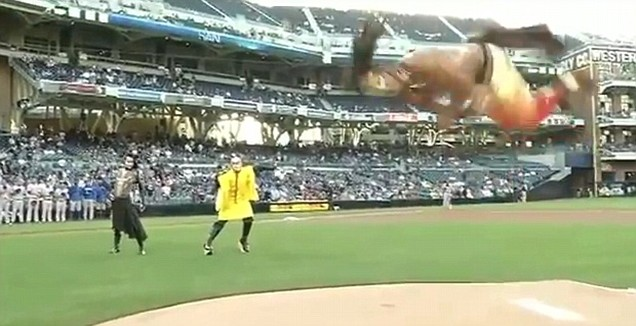 flip-tastic: The Cirque du Soleil performer gets airborne at the baseball (MLB)