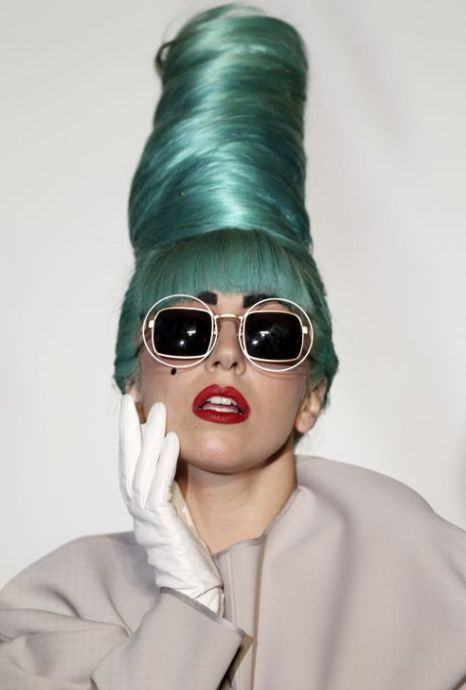 Revelations: Lady Gaga goes green for a concert in Singapore Picture: AP