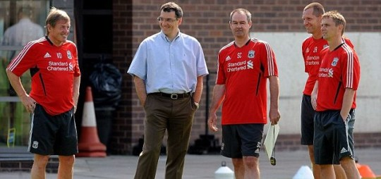 Working together: Kenny Dalglish and Damien Comolli discussing tactics with fellow coaches at Melwood (Getty)
