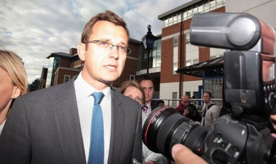 Andy Coulson faces questions as he leaves Lewisham Police station on July 8