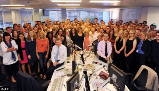 The News Of The World staff gather for their last ever company photo