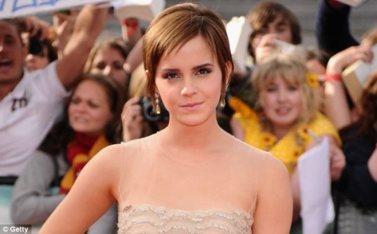 Emma posing at the recent Harry Potter premiere in London, where she became emotional about the franchise's end