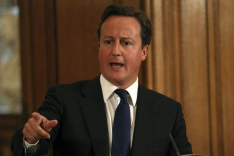 Prime Minister David Cameron speaks during a news conference at Downing Street today
