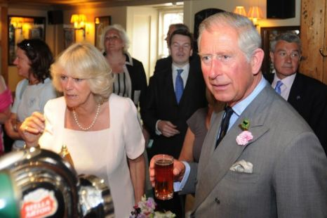Prince Charles, Prince of Wales and Camilla, Duchess of Cornwall enjoy a drink in a pub during their visit to Salcombe yesterday