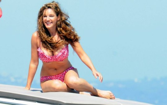 d5a1e68481347 Kelly Brook flaunts figure in floral pink bikini to enjoy last drops of  Italian sun
