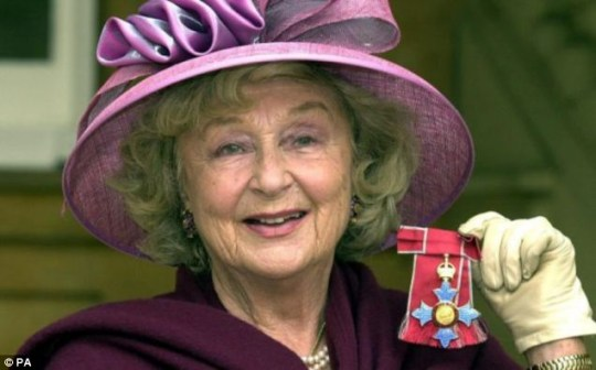 Googie Withers holding her CBE after meeting the Queen in 2002
