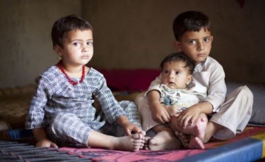 Brighter future: For Fawadullah, with one of his sisters and his brother