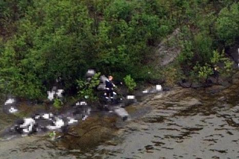 The chilling overhead image showing the scene on Utoeya island, with the gunman surrounded by bodies that have been pixelated because of its graphic nature (Picture: EPA)