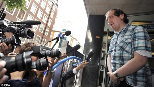 Comedian Jonnie Marbles speaks to waiting reporters following his appearance at Westminster Magistrates' Court today