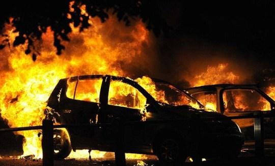 Cars burn on a street in Ealing