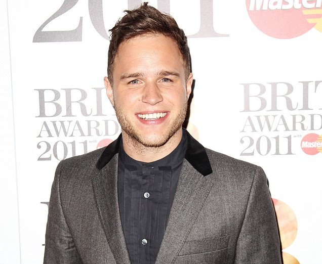 LONDON, ENGLAND - JANUARY 13: (UK TABLOID NEWSPAPERS OUT) Olly Murs attends The Brit Awards 2011 nominations announcement held at Indigo at The O2 Arena on January 13, 2011 in London, England. (Photo by Dave Hogan/Getty Images) *** Local Caption *** Olly Murs