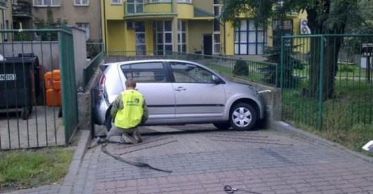 Wiola Nowicka's car wedged in driveway Poland