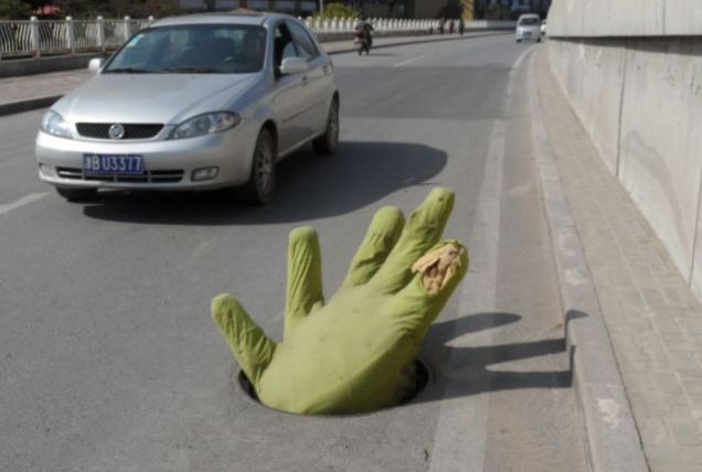 giant green hand manhole China
