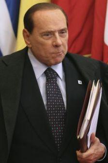 Italian Prime Minister Silvio Berlusconi leaves after the EU summit