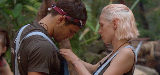 Emily Scott helps Mark Wright with his dungarees in I'm A Celebrity...Get Me Out Of Here! (Picture: Rex)