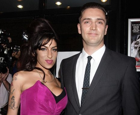 Film director Reg Traviss says he is still too distraught to take up offers to make a biopic of ex-girlfriend Amy Winehouse's life