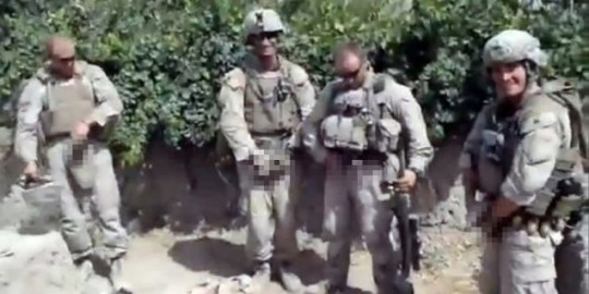 YouTube video shows what appears to be US Marines urinating on the bodies of dead Taliban soldiers in Afghanistan (Picture: Reuters)