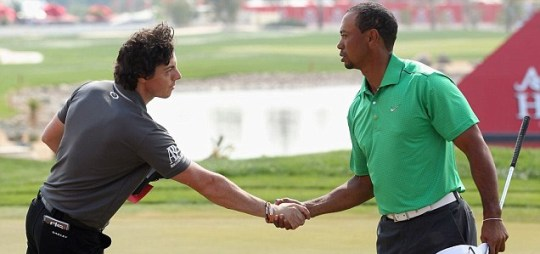 Rory McIlroy of Northern Ireland shakes hands with Tiger Woods of the USA
