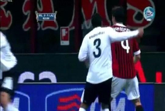 Lazio's Andre Dias clocks Milan's  Mark van Bommel