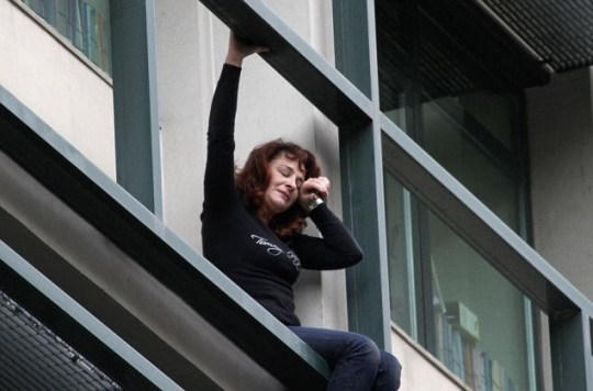 Lambrousi Harikleia, an employee of the Workers' Housing Organisation, cries as she threatens to jump from her office