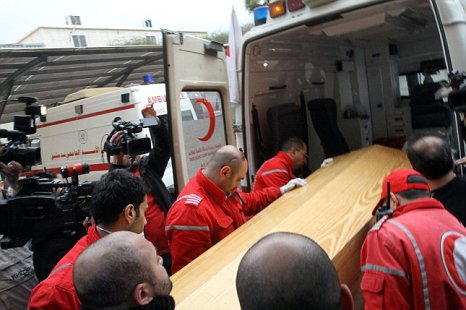 The coffin of American journalist Marie Colvin of the Sunday Times is carried on to an ambulance in Damascus