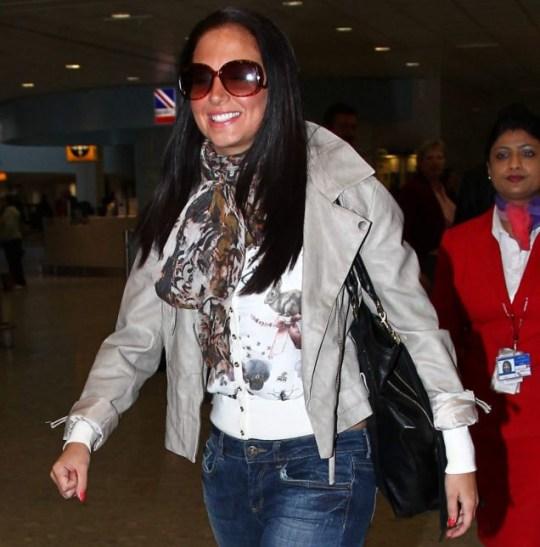 Tulisa arrives at Heathrow
