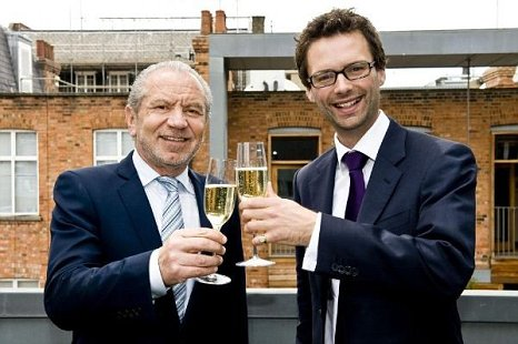 Tom Pellereau celebrates with Lord Sugar following his Apprentice win (Picture: PA)