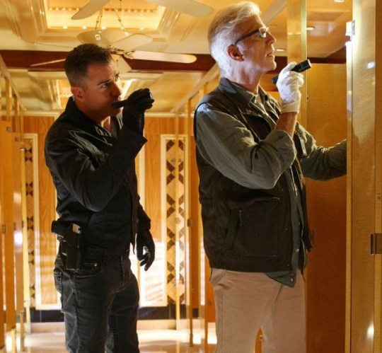 Nick Stokes (George Eads, left) and D.B. Russell (Ted Danson) look for clues after multiple shootings and stabbings on a public tram in CSI