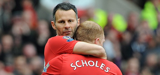 Manchester United's Ryan Giggs congratulates team mate Paul Scholes