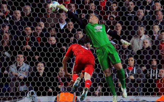 Liverpool's English forward Andy Carroll (L) scores his team's third goal past Blackburn Rovers' English goalkeeper Paul Robinson