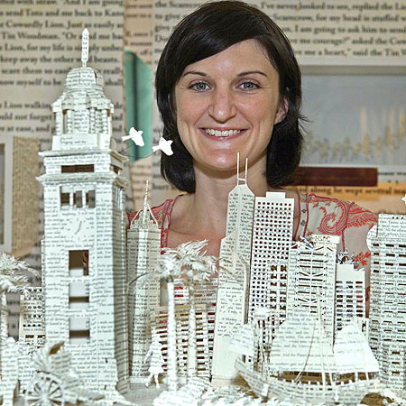 A cut above: Su Blackwell shows off her paper skyline of Hong Kong