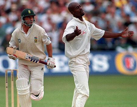 Former England bowler Chris Lewis (R) has been found guilty of cocaine smuggling